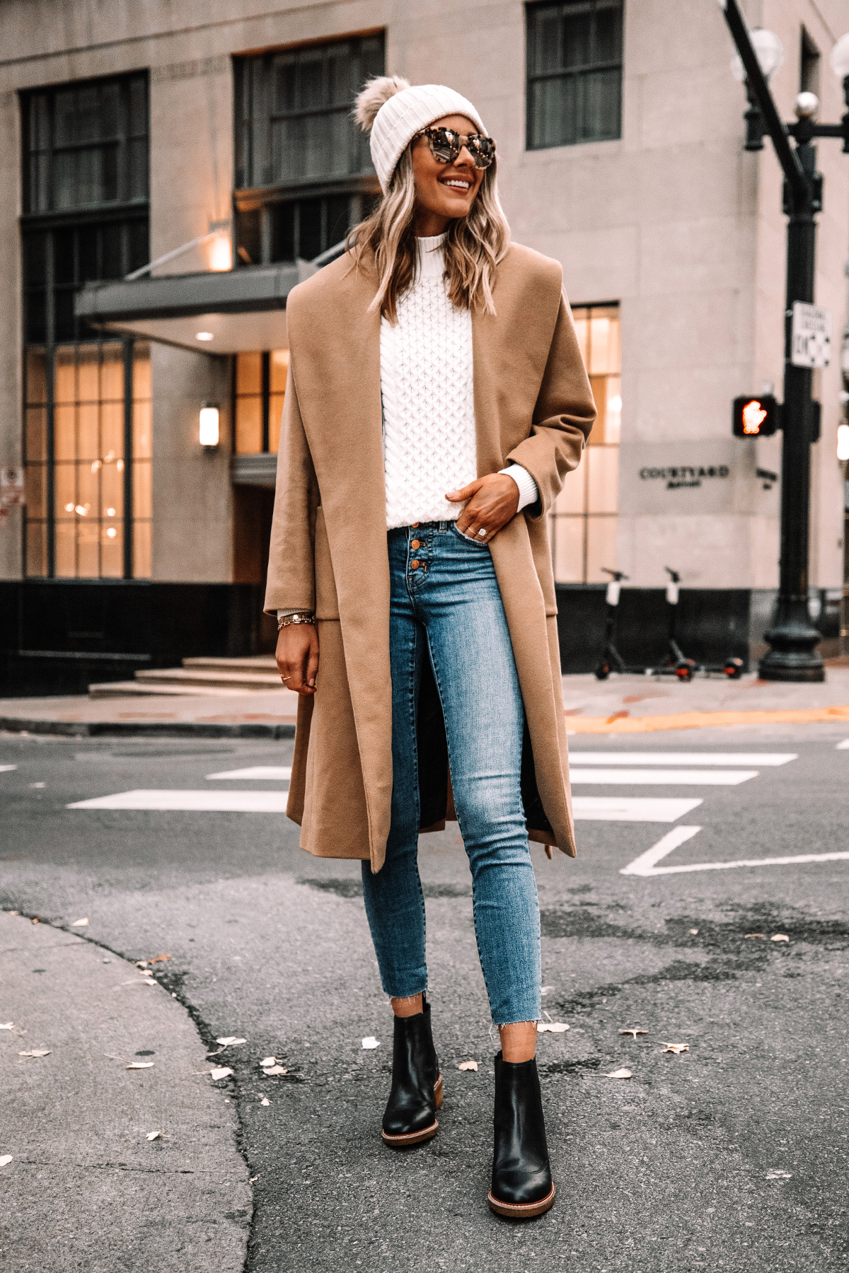 Fashion Jackson Wearing Jcrew Camel Wrap Coat White Swetaer Raw Hem Jeans Black Lug Sole Boots White Beanie Winter Outfit Street Style
