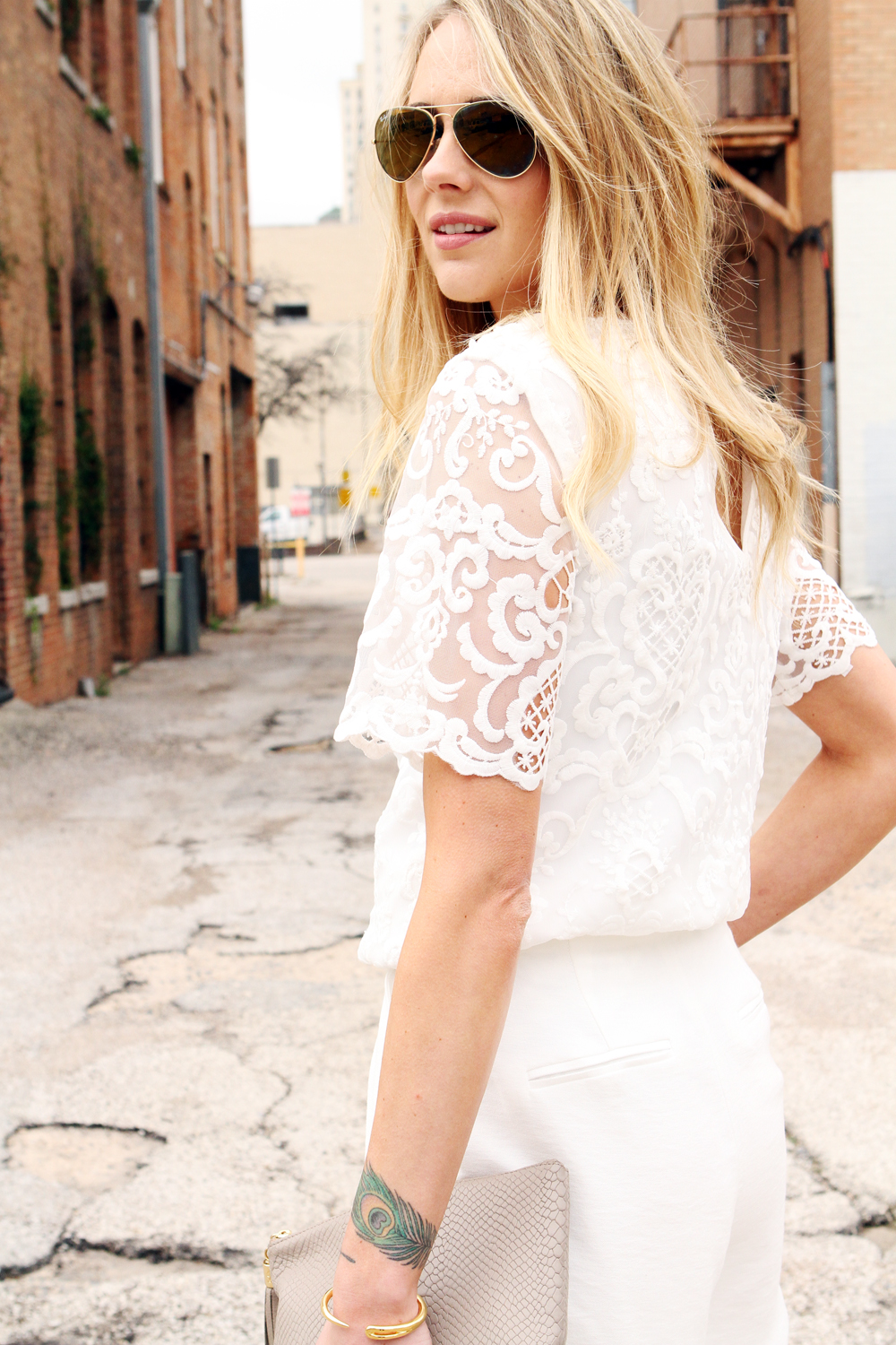 french connection nebraska lace tunic top, white lace top, white wide leg pants, nude clutch,