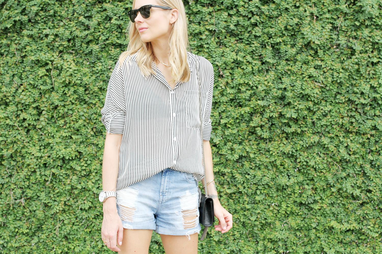 striped button up shirt-ripped denim shorts-ysl crossbody-ray ban sunglasses