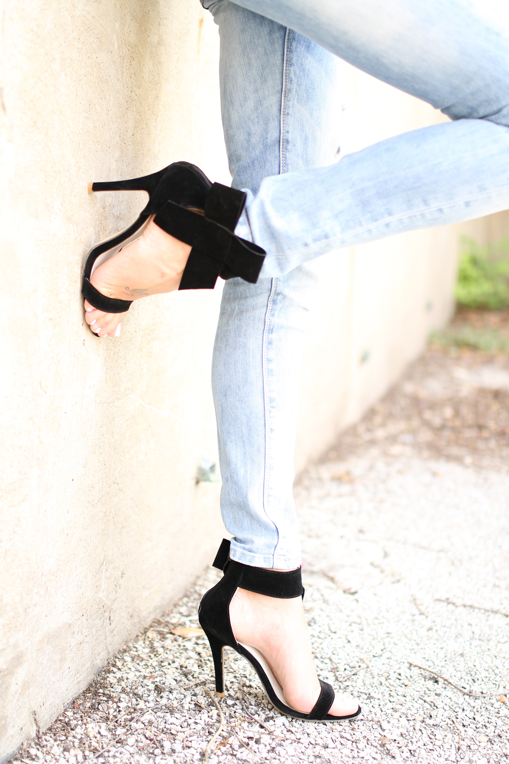 black bow heels-ripped skinny jeans