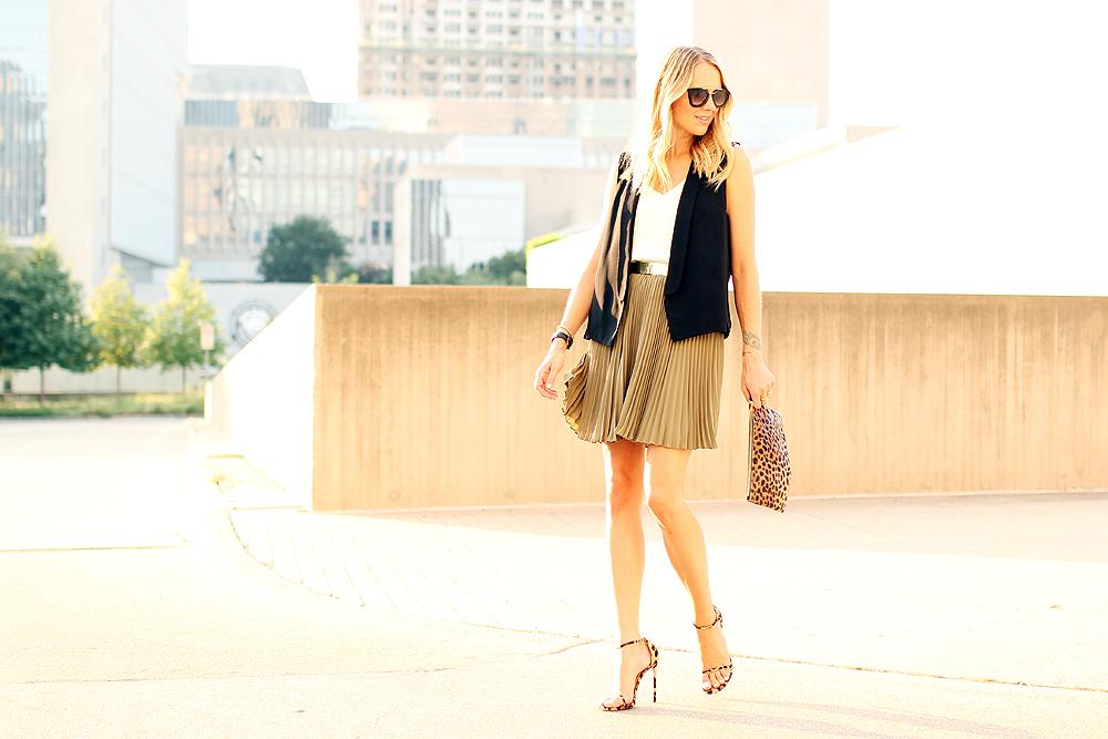 fashion-jackson-black-vest-banan-republic-olive-soft-pleated-skirt-clare-v-leopard-clutch-stuart-weitzman-leopard-heels