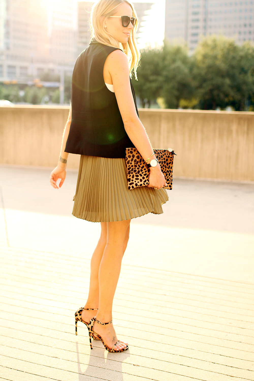 fashion-jackson-black-vest-banana-republic-olive-soft-pleated-skirt-stuart-weitzman-leopard-heels-clare-v-leopard-clutch-prada-cateye-sunglasses