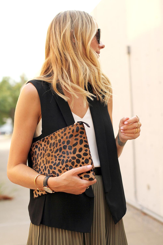 fashion-jackson-black-vest-clare-v-leopard-clutch-banana-republic-olive-soft-pleated-skirt