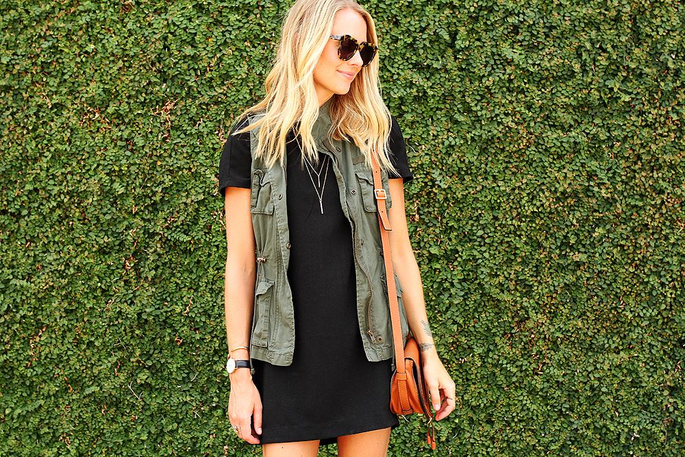 fashion-jackson-short-sleeve-black-dress-olive-utility-vest-gold-layered-necklace-karen-walker-number-one-sunglasses-chloe-marcie-small-crossbody