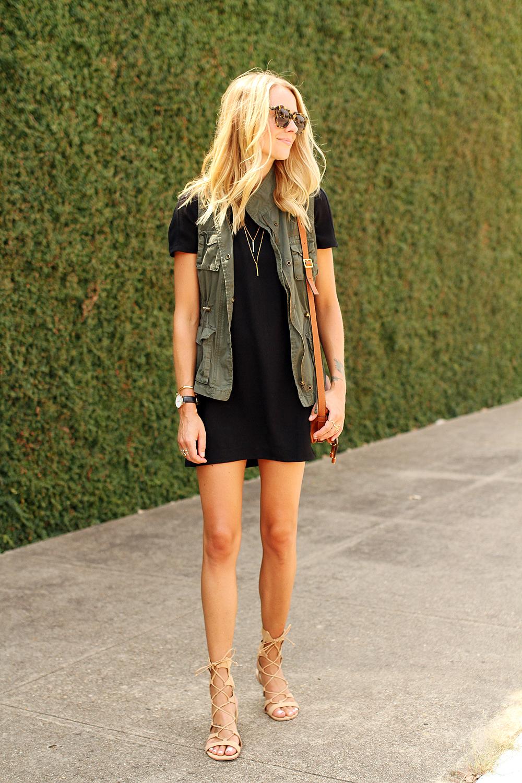 fashion-jackson-short-sleeve-black-dress-olive-utility-vest-gold-layered-necklace-karen-walker-number-one-sunglasses-chloe-marice-small-crossbody-schutz-gladiator-lace-up-sandals