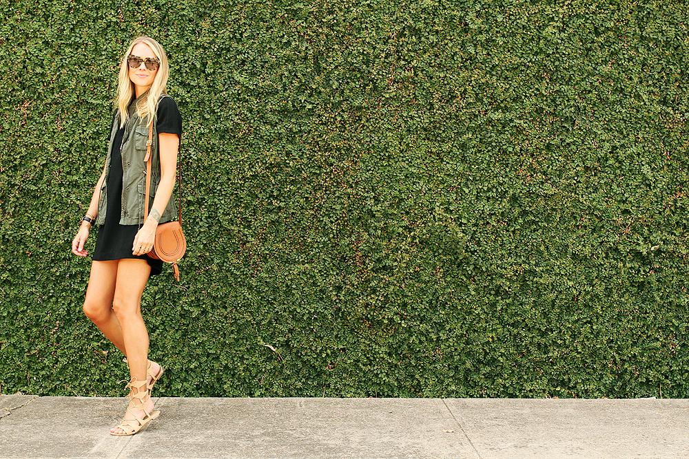 fashion-jackson-short-sleeve-black-dress-olive-utility-vest-karen-walker-number-one-sunglasses-schutz-gladiator-lace-up-sandals-schutz-gladiator-lace-up-sandals
