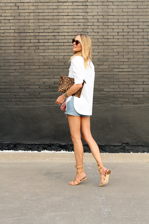 fashion-jackson-topshop-white-button-up-shirt-ripped-denim-shorts-clare-v-leopard-clutch-schutz-lace-up-gladiator-sandals-karen-walker-sunglasses
