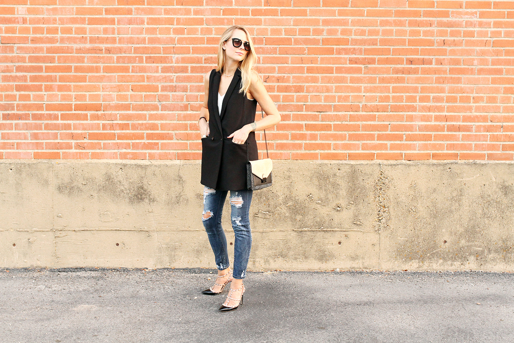 fashion-jackson-banana-republic-black-long-line-vest-ripped-skinny-jeans-prada-sunglasses-valentino-rockstuds