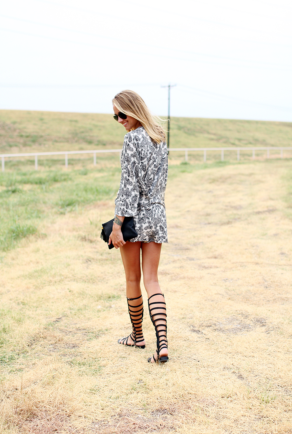 fashion-jackson-stuart-weitzman-black-gladiator-sandals-printed-romper-gigi-new-york-clutch