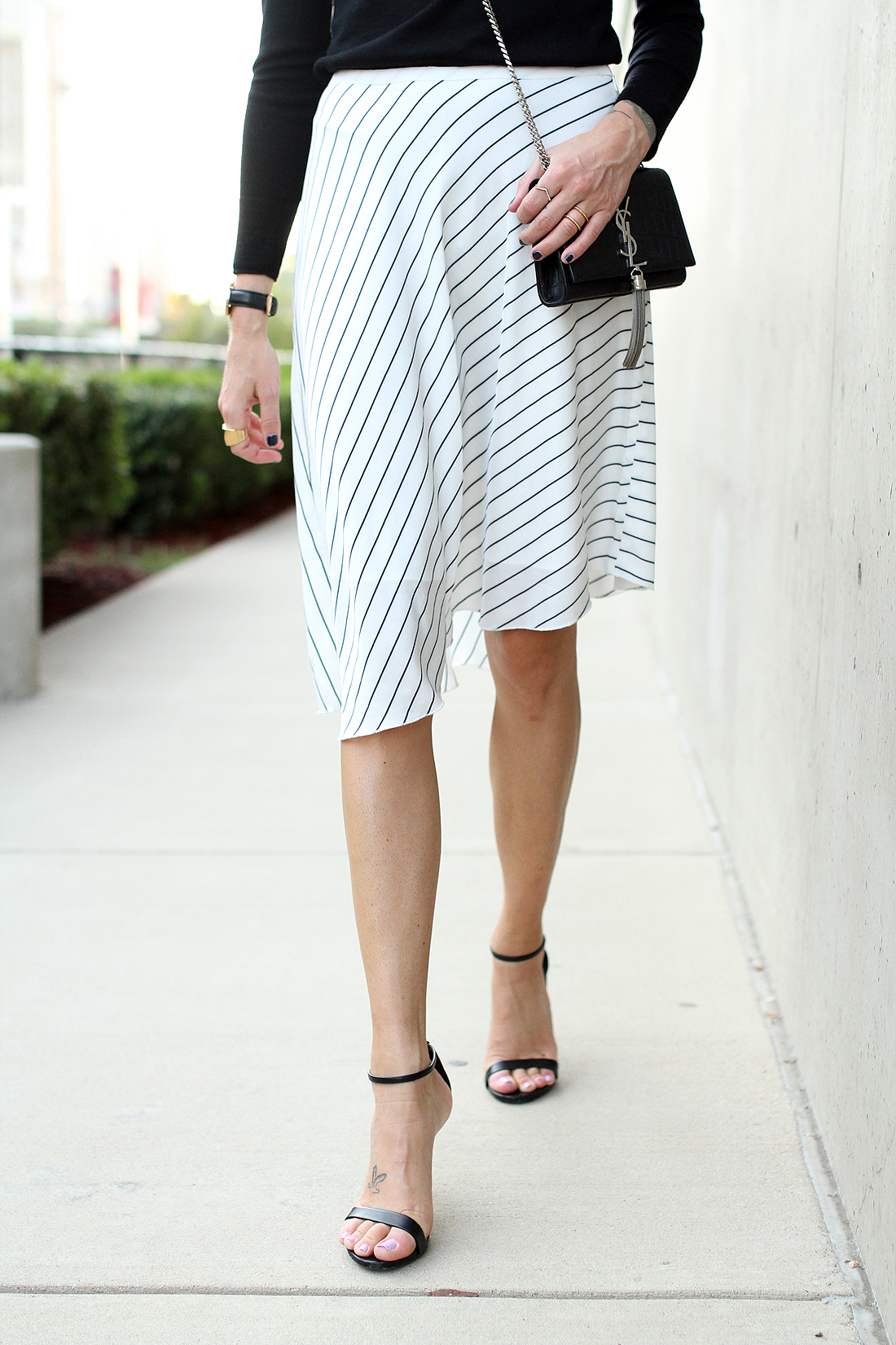 fashion-jackson-club-monaco-white-asymmetrical-skirt-black-ankle-strap-heels-saint-laurent-crossbody