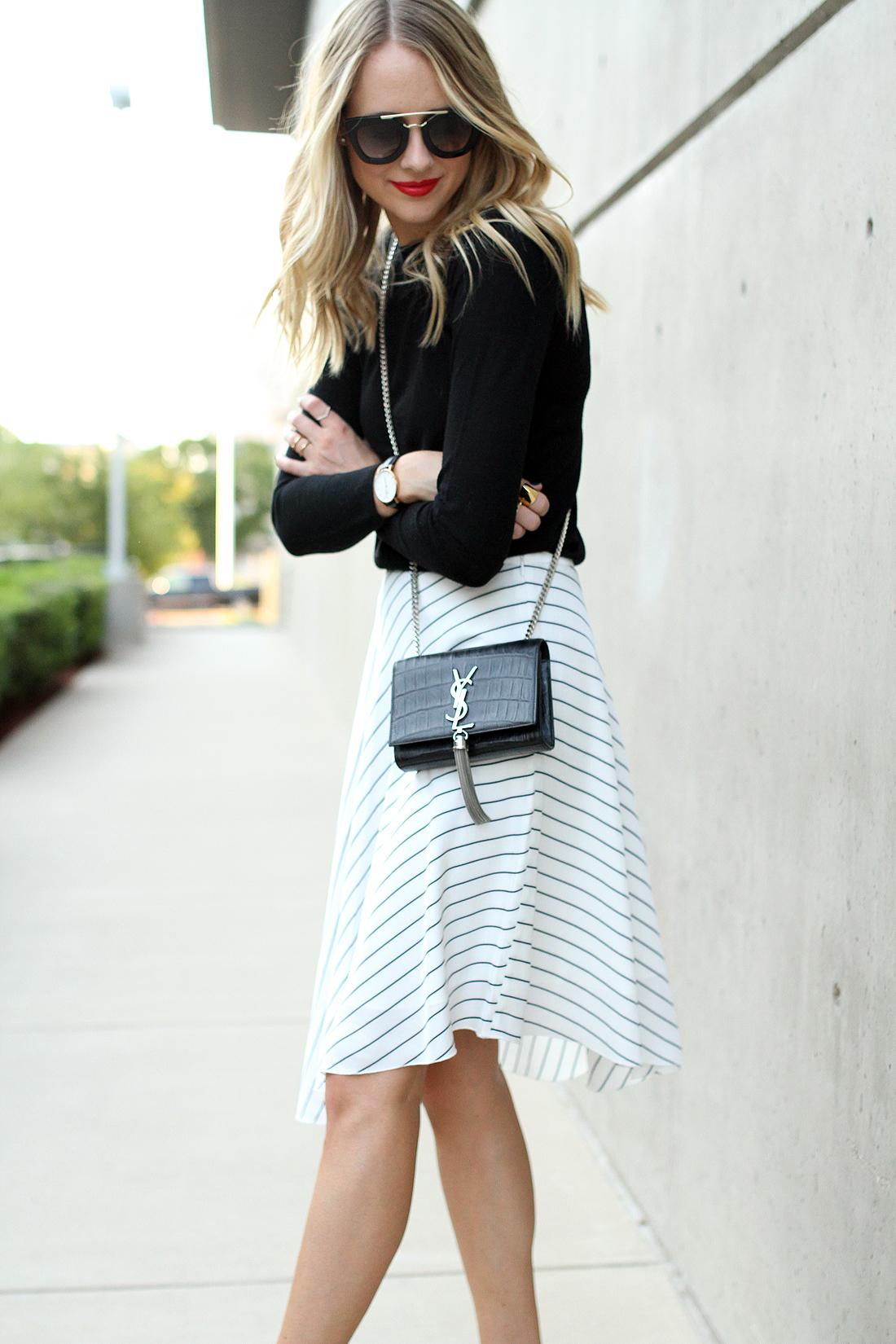 fashion-jackson-club-monaco-white-asymmetrical-skirt-black-sweater-prada-sunglasses-red-lipstick-saint-laurent-tassel-crossbody