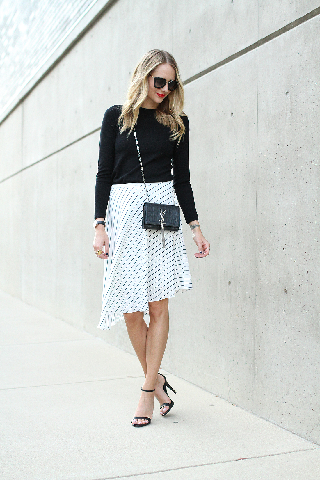 fashion-jackson-club-monaco-white-asymmetrical-skirt-black-sweater-prada-sunglasses-saint-laurent-crossbody