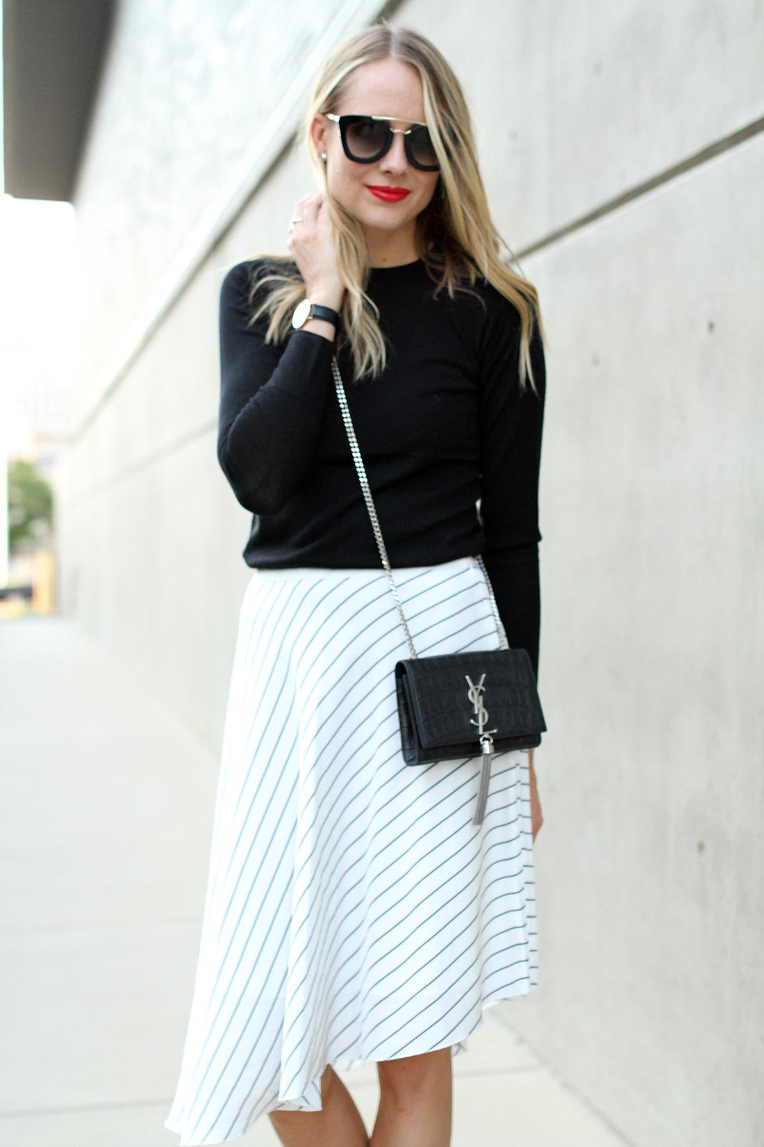 fashion-jackson-club-monaco-white-asymmetrical-skirt-black-sweater-prada-sunglasses-saint-laurent-tassel-crossbody