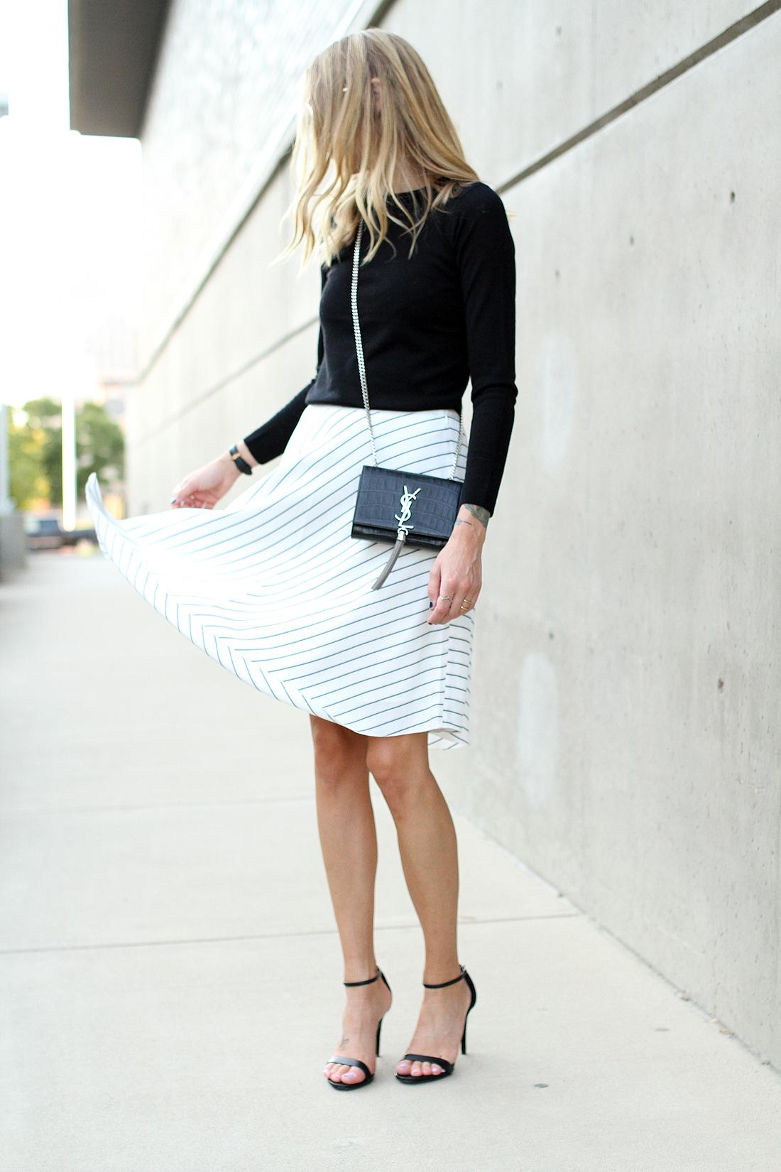 fashion-jackson-club-monaco-white-asymmetrical-skirt-black-sweater-saint-laurent-tassel-crossbody-black-ankle-strap-heels