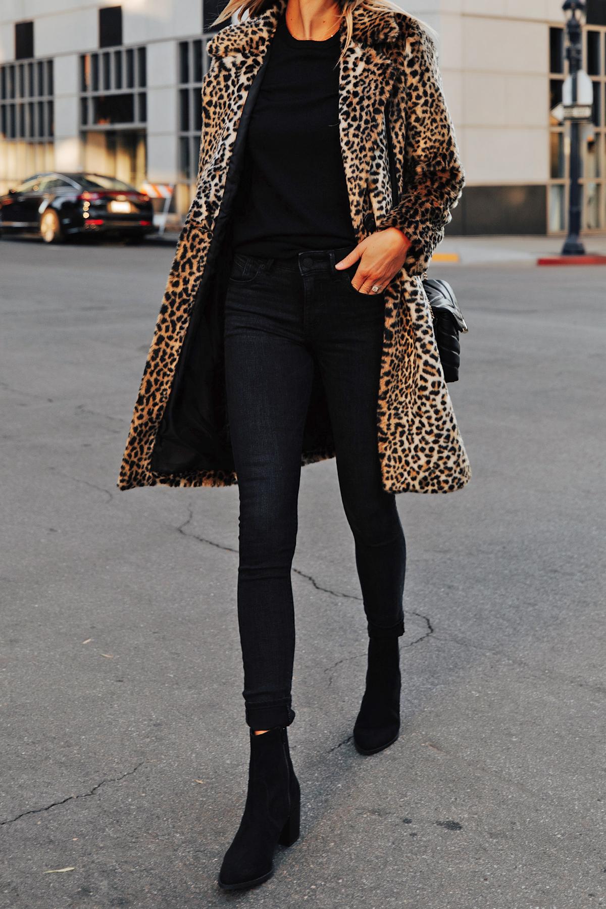 Fashion Jackson Wearing Express Faux Fur Leopard Coat Black Sweater Black Jeans Black Booties Christmas Outfit Idea