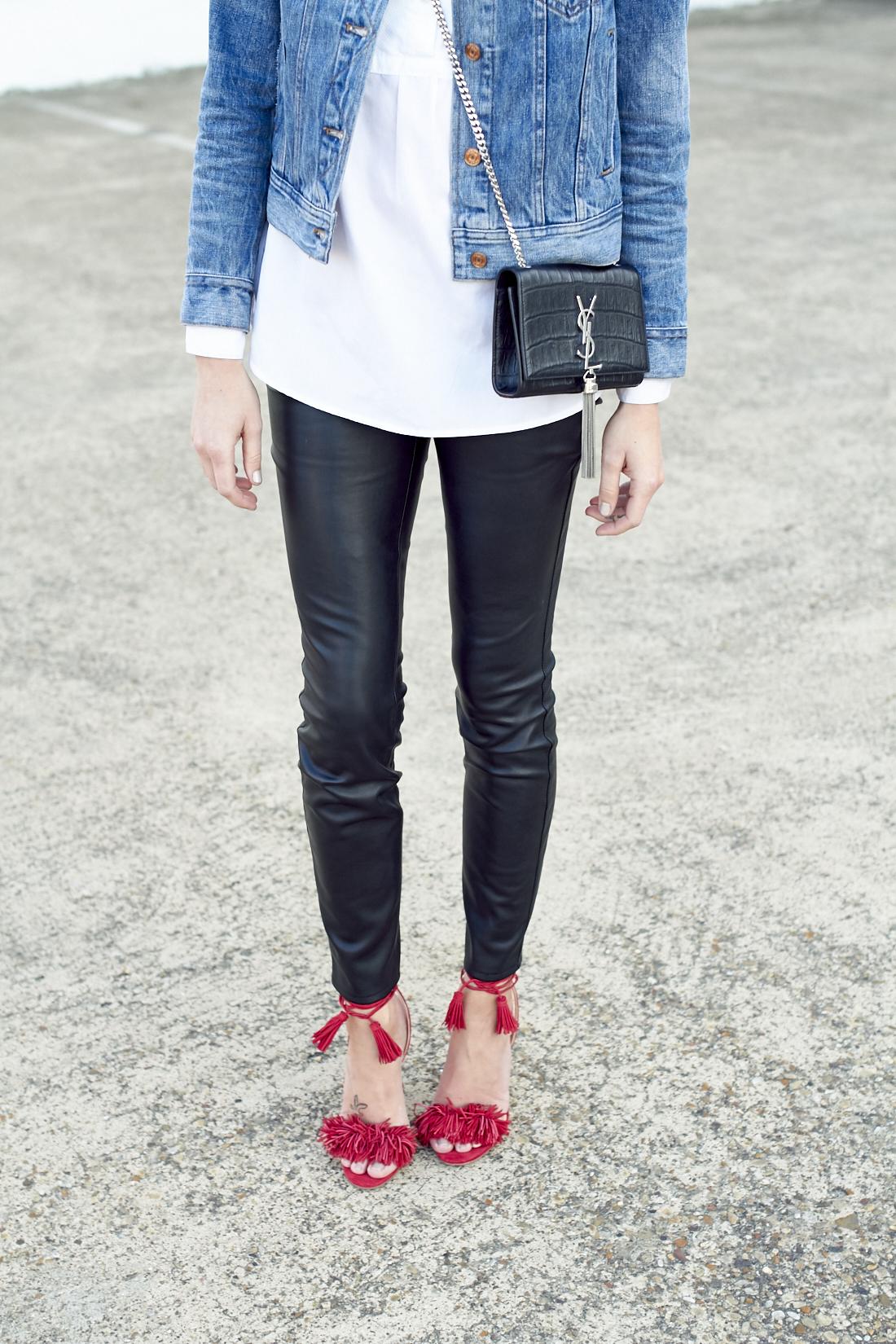 fashion-jackson-black-faux-leather-pants-red-fringe-heels-denim-jacket-saint-laurent-monogram-handbag