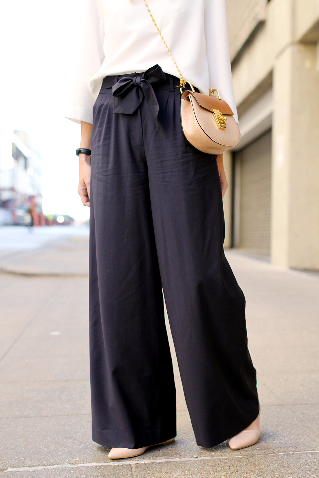 A wide leg pant looks best with a heavier bottom to balance the proportion of the full leg- remember, there is a 70's vibe to this trend. That means, keep those pointy stilettos away and look for a stacked heel, more rounded toe, platforms, espadrilles, weudge, or the super on trend flatforms– all with the idea to create the illusion of a.