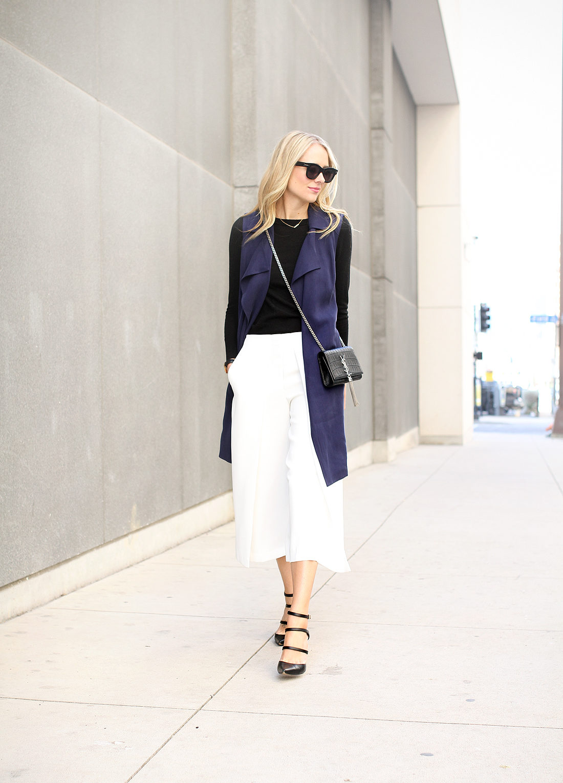 fashion-jackson-white-culottes-black-sweater-navy-trench-vest-black-triple-strap-pumps-black-celine-sunglasses-saint-laurent-monogram-handbag