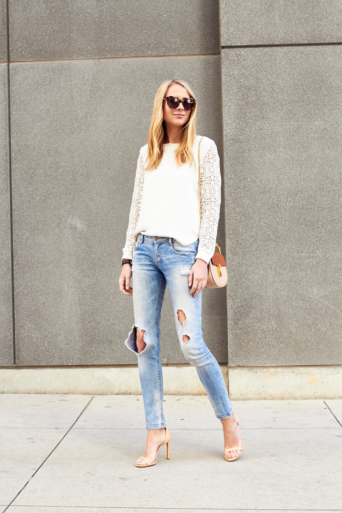 fashion_jackson_white_lace_sleeve_blosue_ripped_denim_skinny_jeans_nude_ankle_strap_heels_chloe_drew_handbag