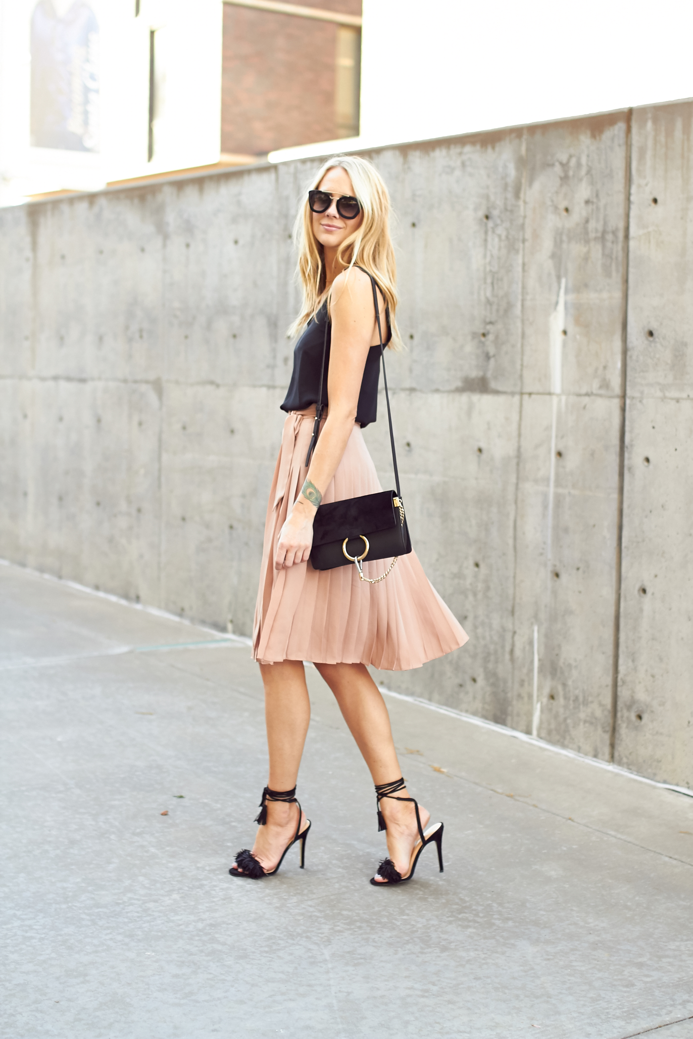 fashion-jackson-chloe-black-faye-handbag-pink-pleated-skirt-black-fringe-heels
