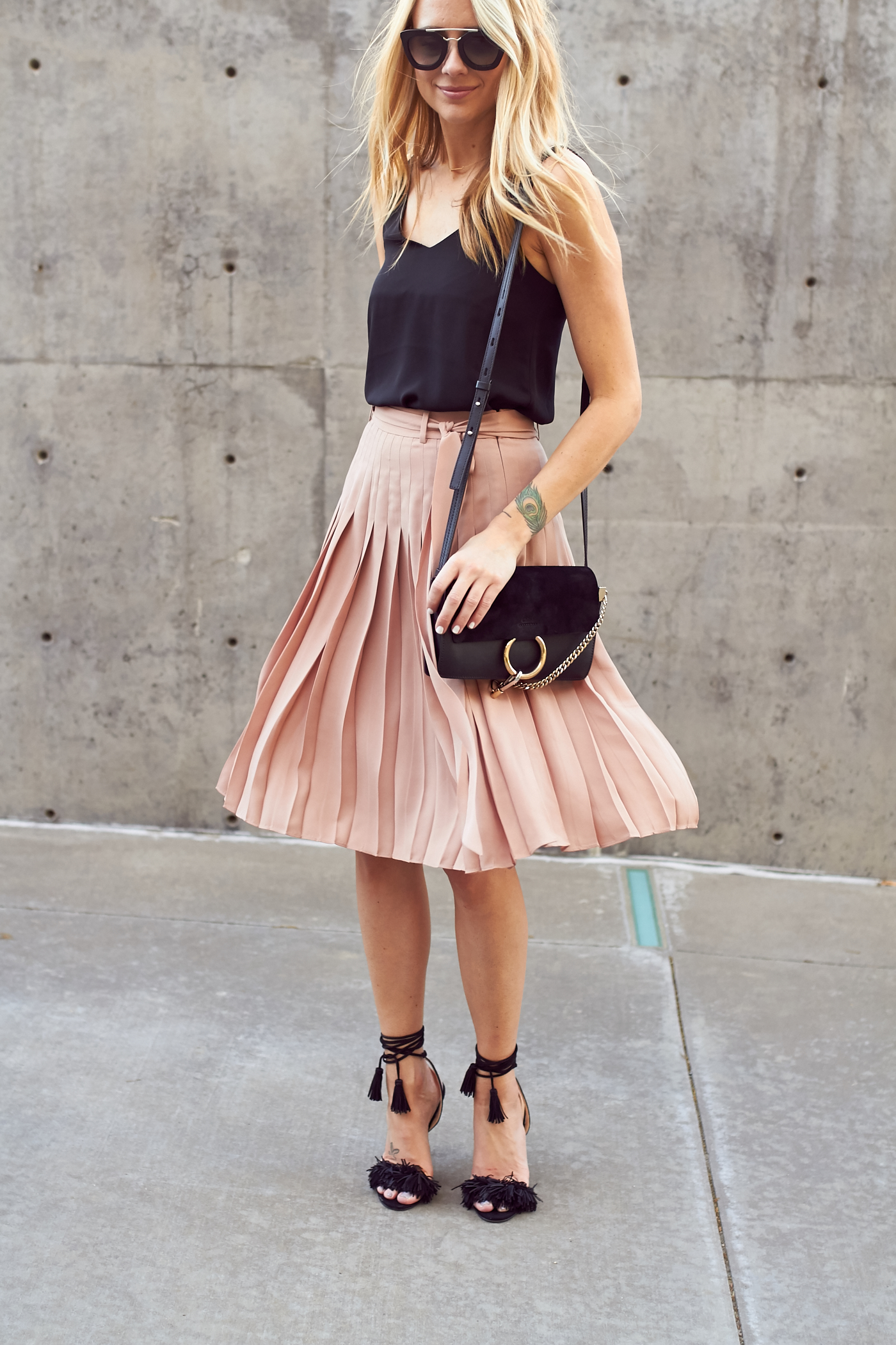 fashion-jackson-chloe-faye-handbag-pink-pleated-skirt-black-fringe-sandal-heels