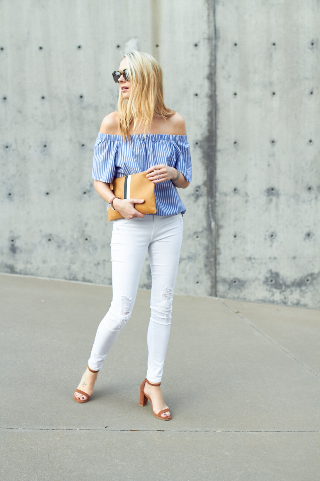fashion-jackson-banana-republic-blue-stripe-off-the-shoulder-top-white-skinny-jeans-stuart-weitzman-nearly-nude-sandals-clare-v-clutch
