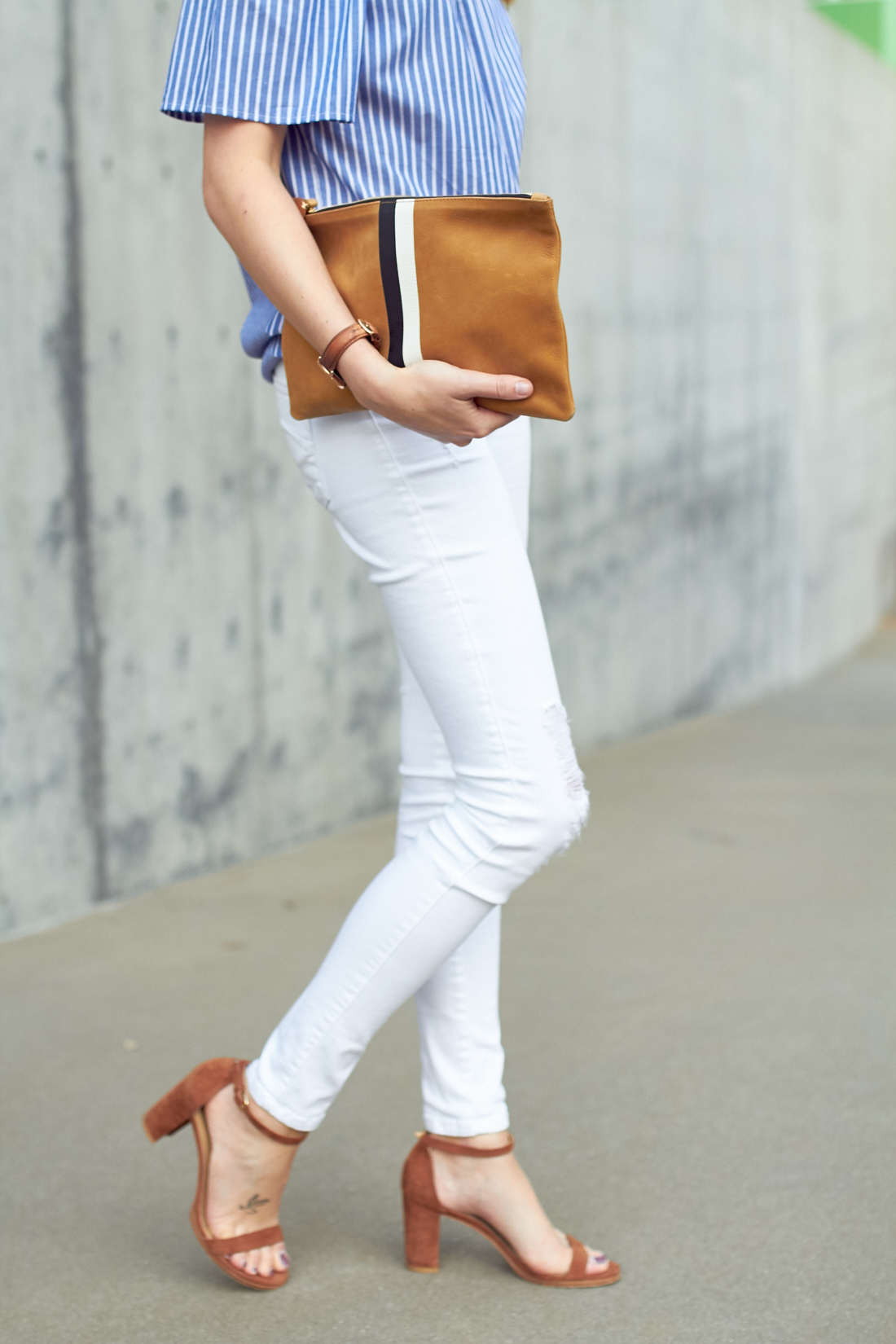 fashion-jackson-blue-stripe-off-the-shoulder-top-white-skinny-jeans-stuart-weitzman-nearly-nude-sandals-clare-v-clutch