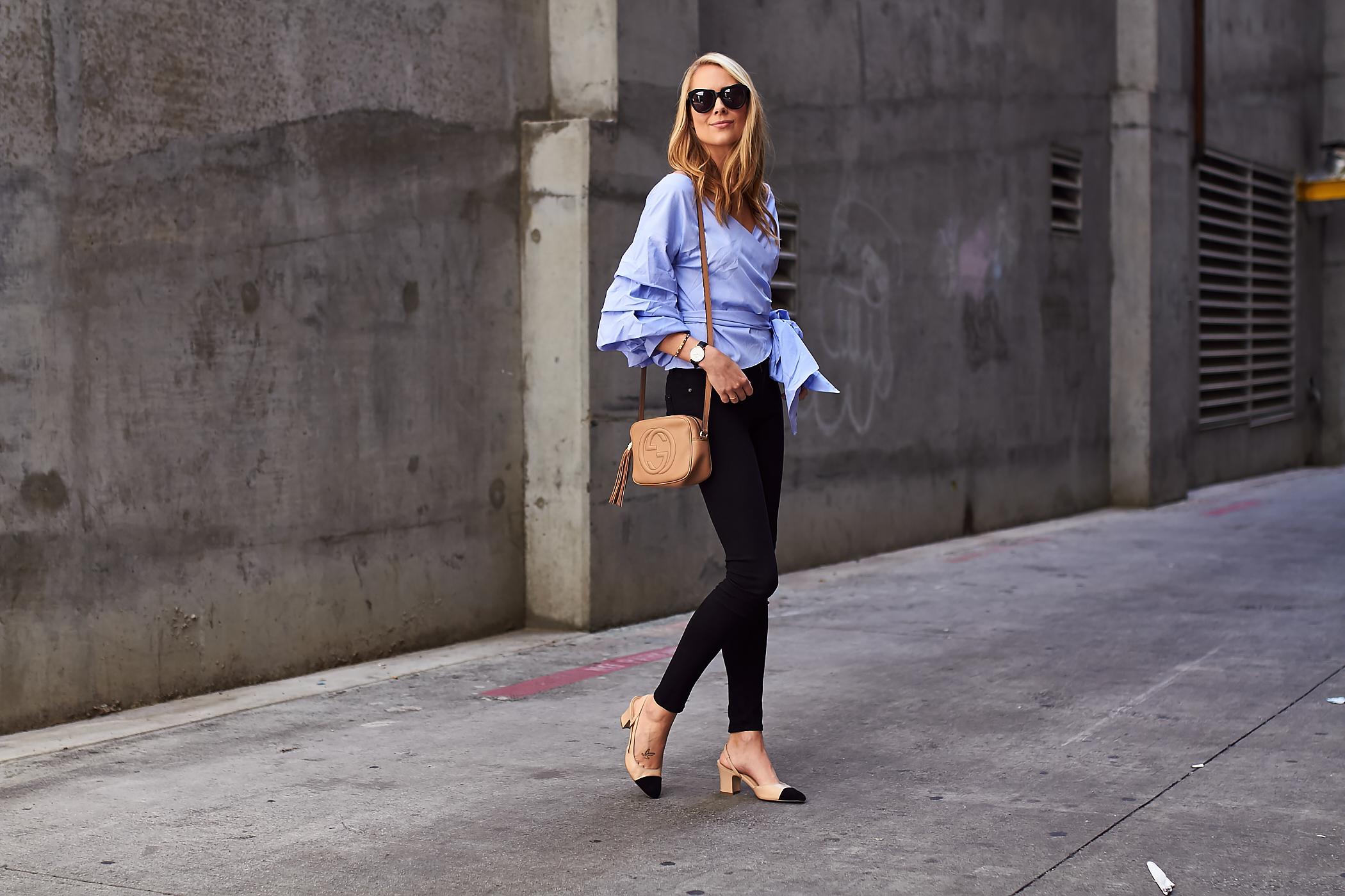 fashion-jackson-blue-ruffle-sleeve-wrap-top-black-skinny-jeans-gucci-soho-crossbody