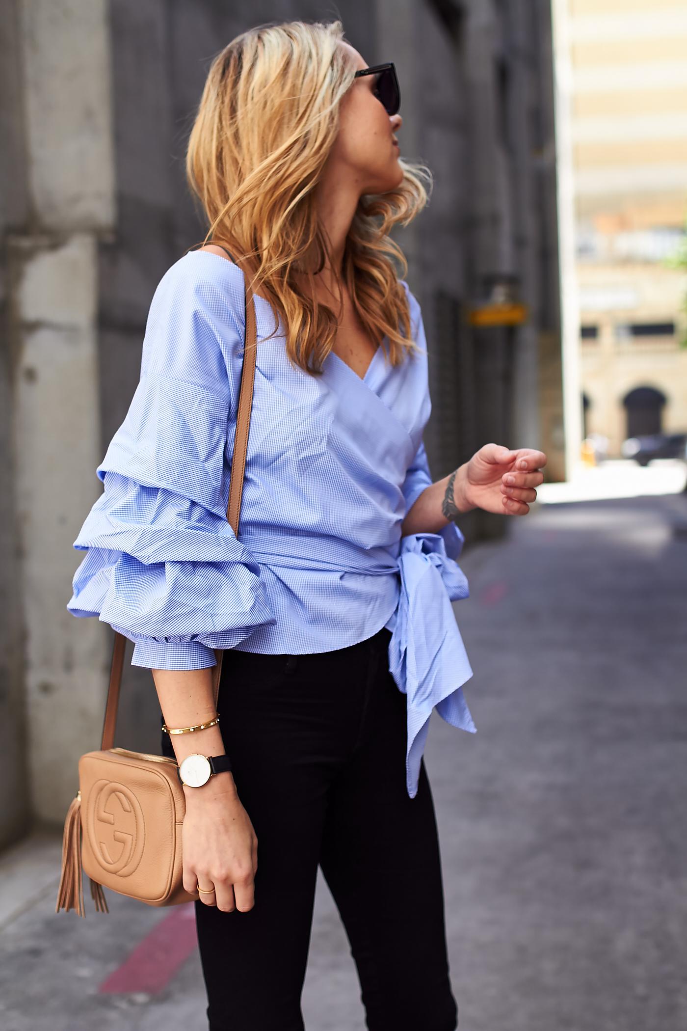 fashion-jackson-blue-ruffle-sleeve-wrap-top-gucci-soho-handbag-black-skinny-jeans