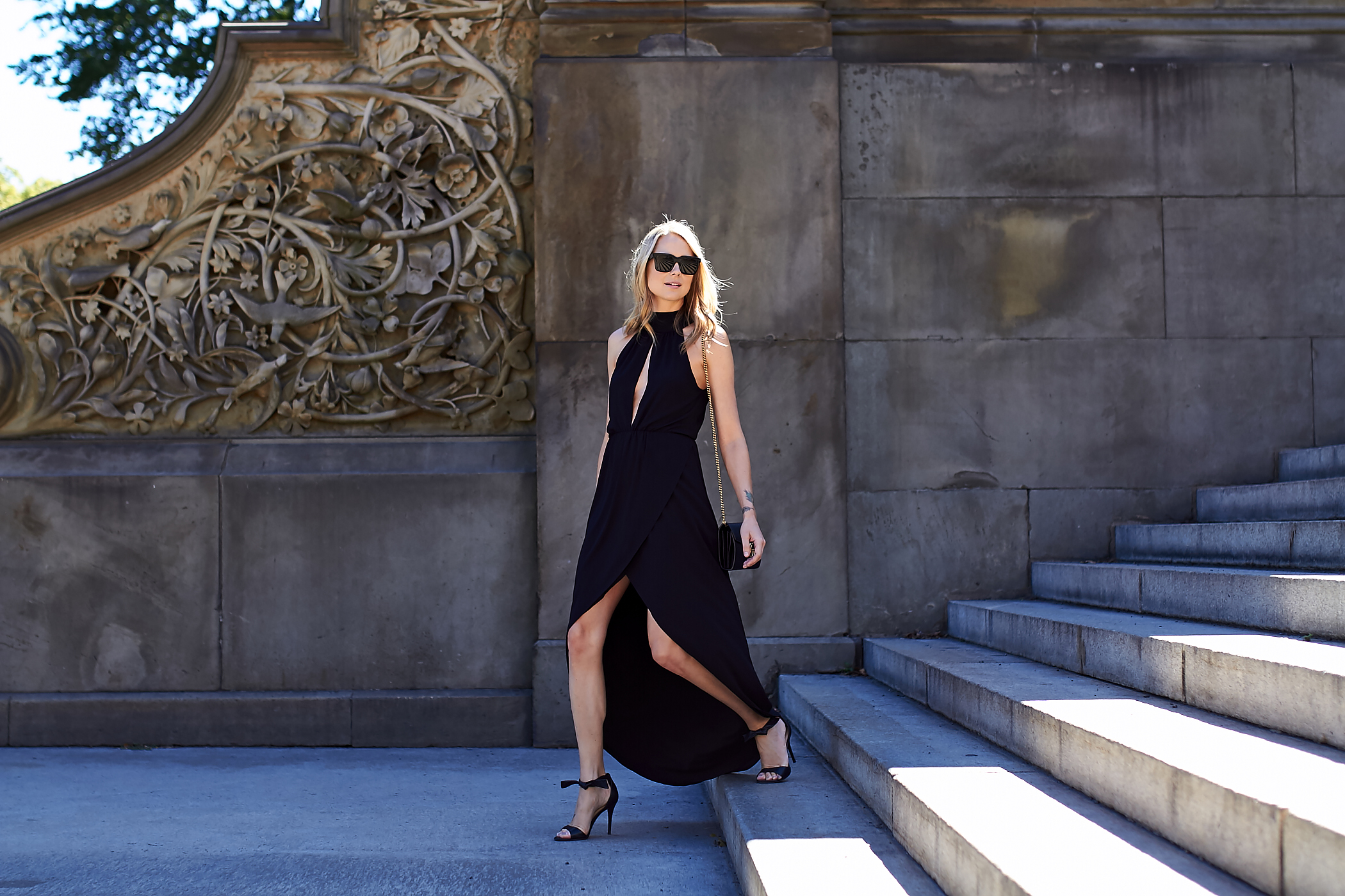 fahsion-jackson-black-sunglasses-black-high-low-hem-dress-black-bow-heels
