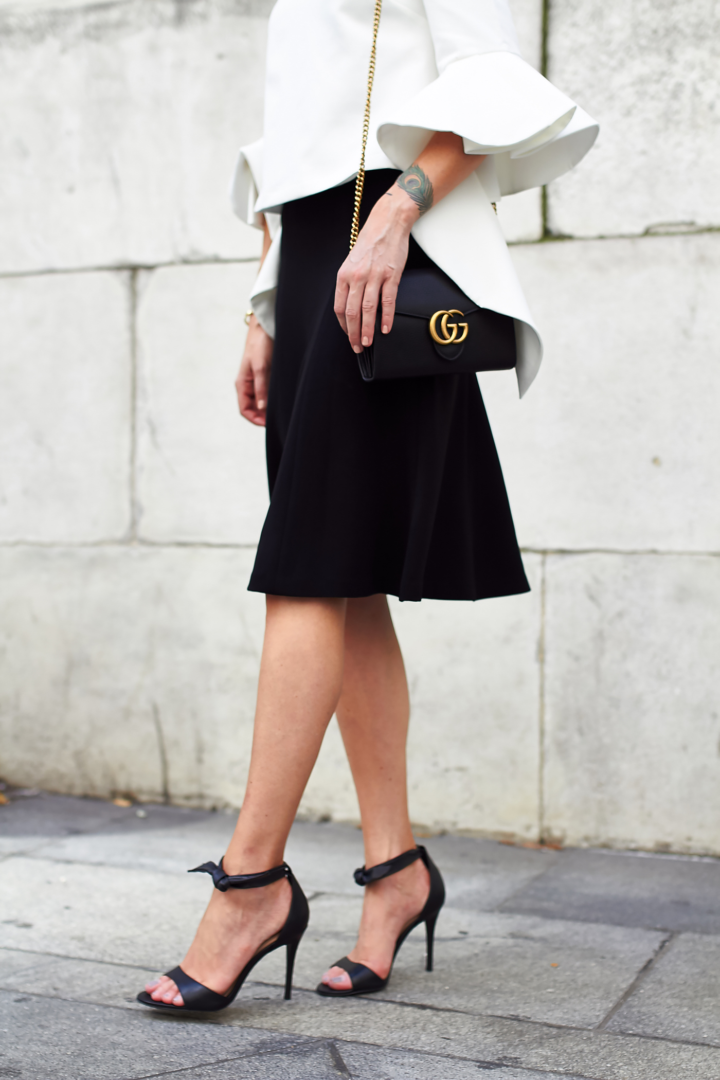 fashion-jackson-club-monaco-dalphine-black-midi-skirt-black-bow-heels-ruffle-sleeve-top-black-gucci-marmont-handbag