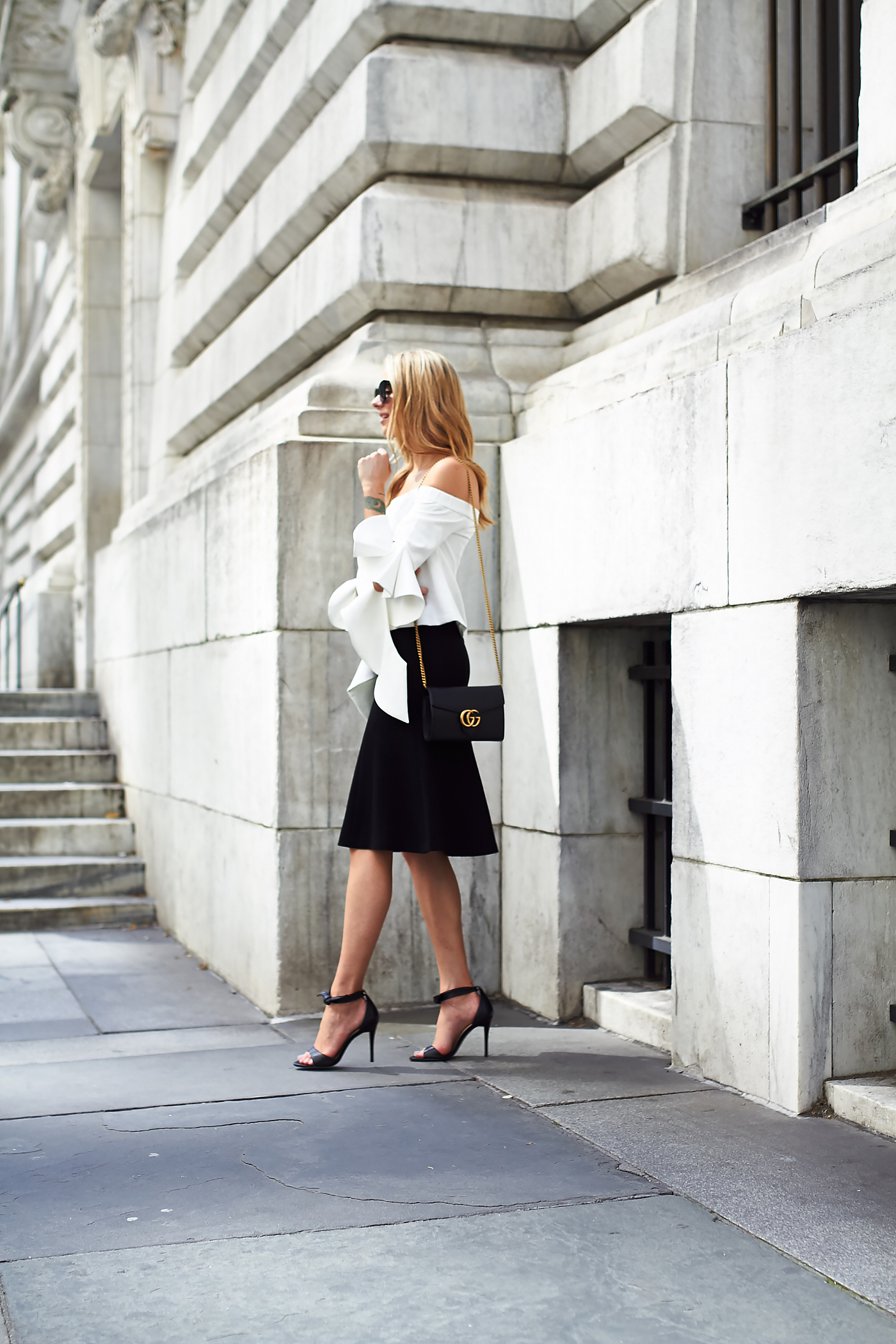 fashion-jackson-white-off-the-shoulder-top-black-midi-skirt-black-heels-black-gucci-marmont-handbag
