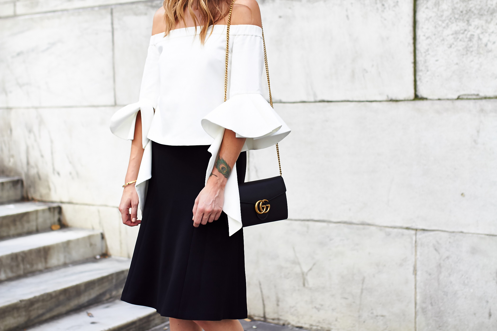 fashion-jackson-white-ruffle-off-the-shoulder-top-black-midi-skirt-gucci-marmont-handbag