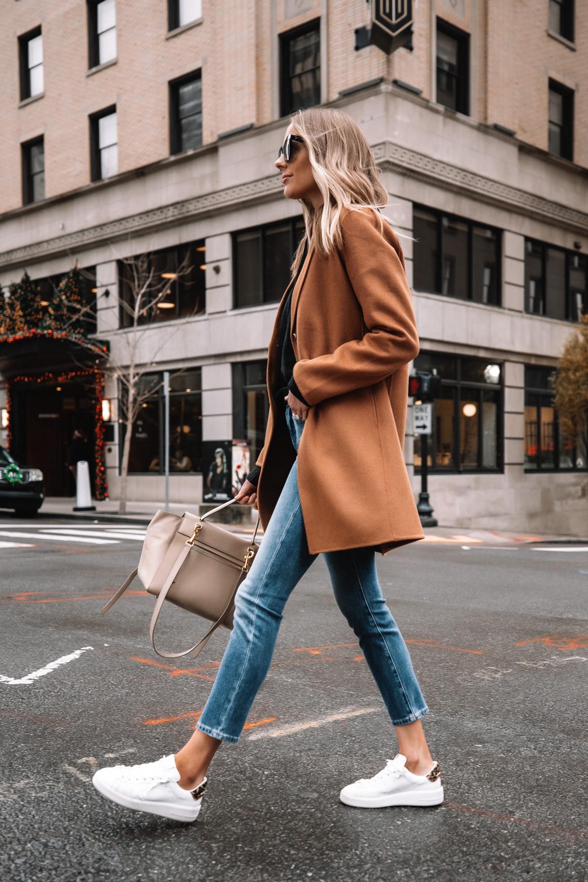 Fashion Jackson Wearing Banana Republic Camel Coat Black Hoodie Sweater Denim Ankle Jeans White Sneakers Street Style 1