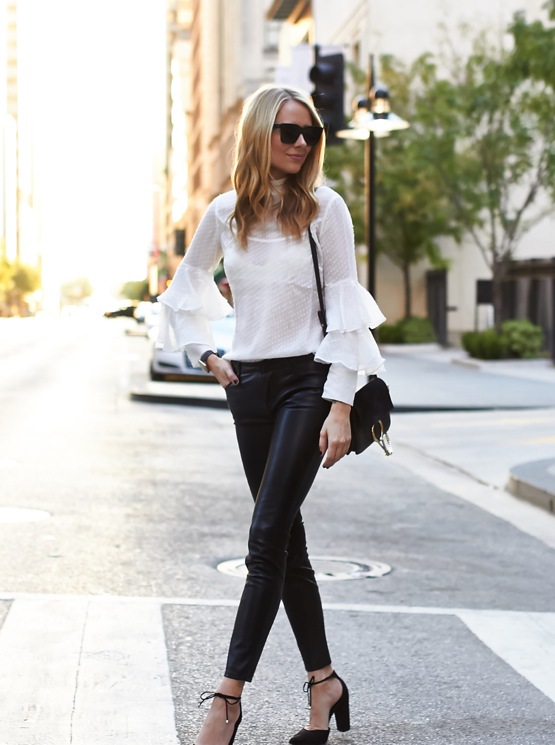 fashion-jackson-black-faux-leather-pants-white-ruffle-sleeve-blouse-black-bow-pumps