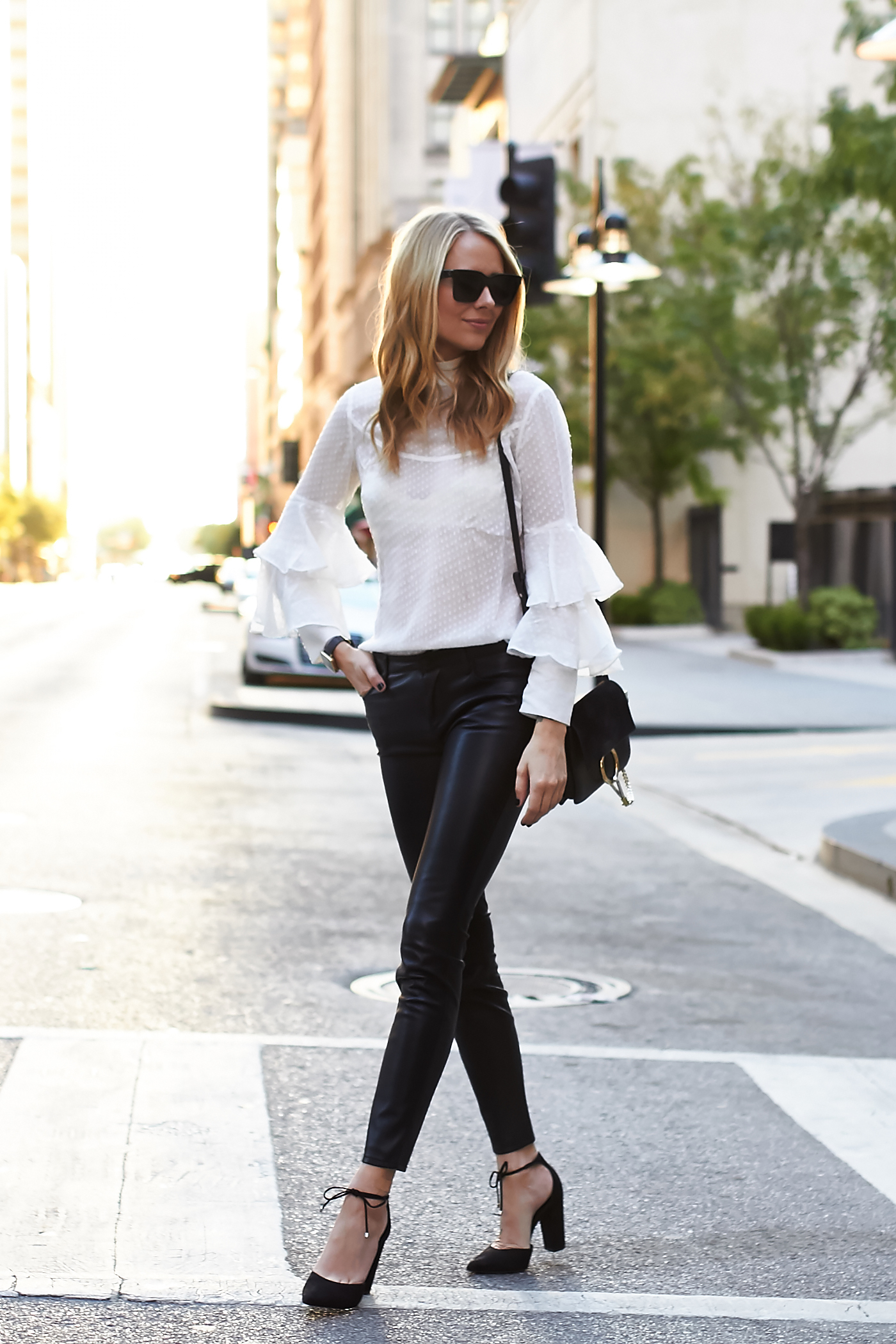 fashion-jackson-black-faux-leather-pants-white-ruffle-sleeve-blouse-black-bow-pumps