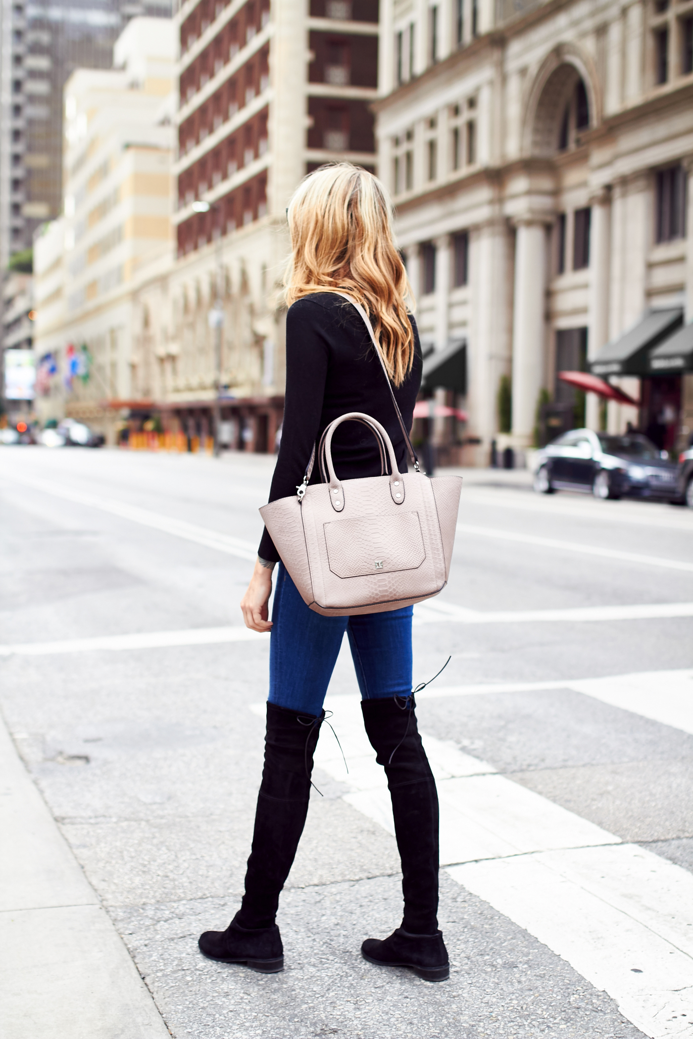 fashion-jackson-black-sweater-denim-skinny-jeans-black-over-the-knee-boots-ivanka-trump-tribeca-embossed-leather-tote