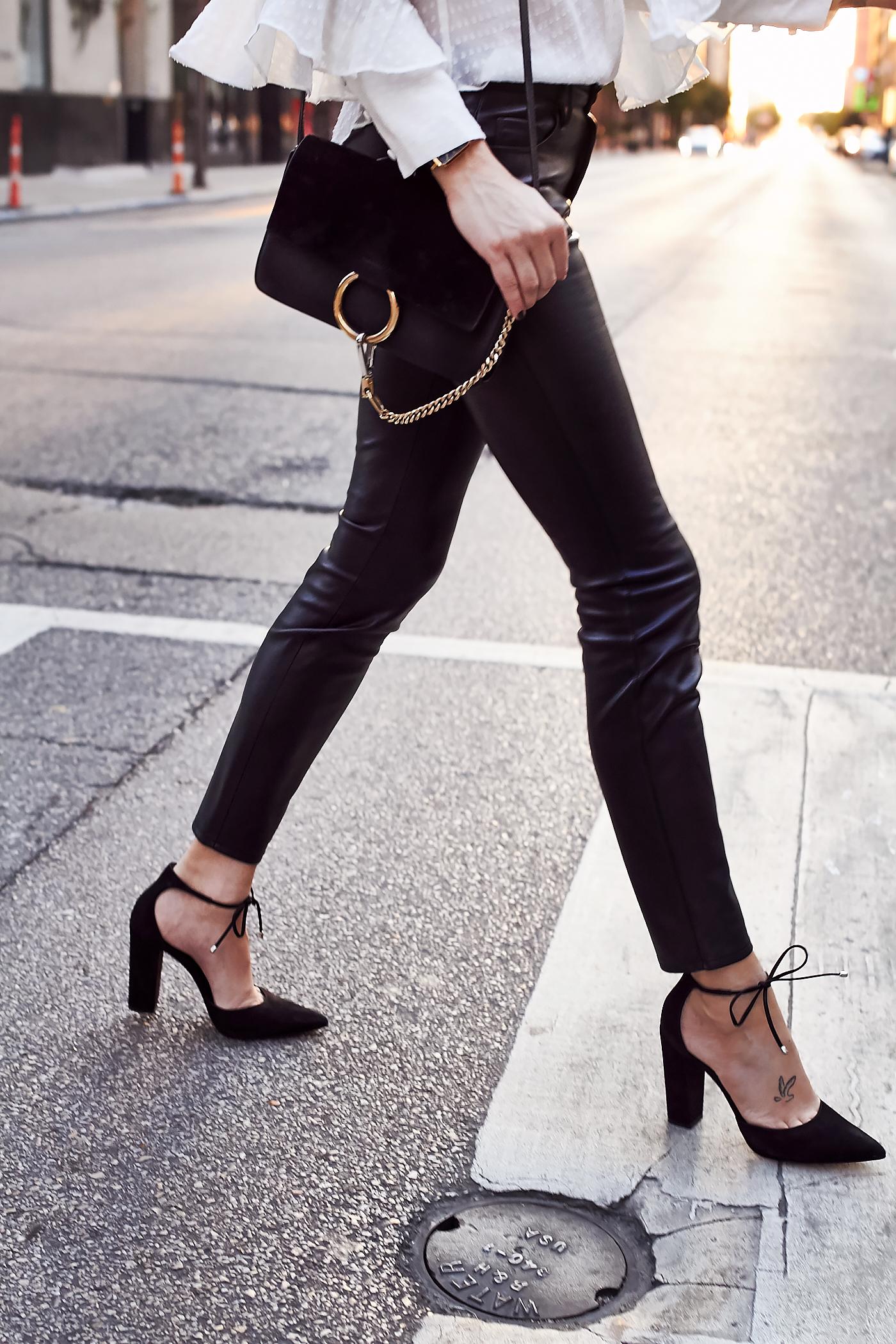 fashion-jackson-chloe-faye-handbag-black-faux-leather-skinny-pants-black-bow-pumps