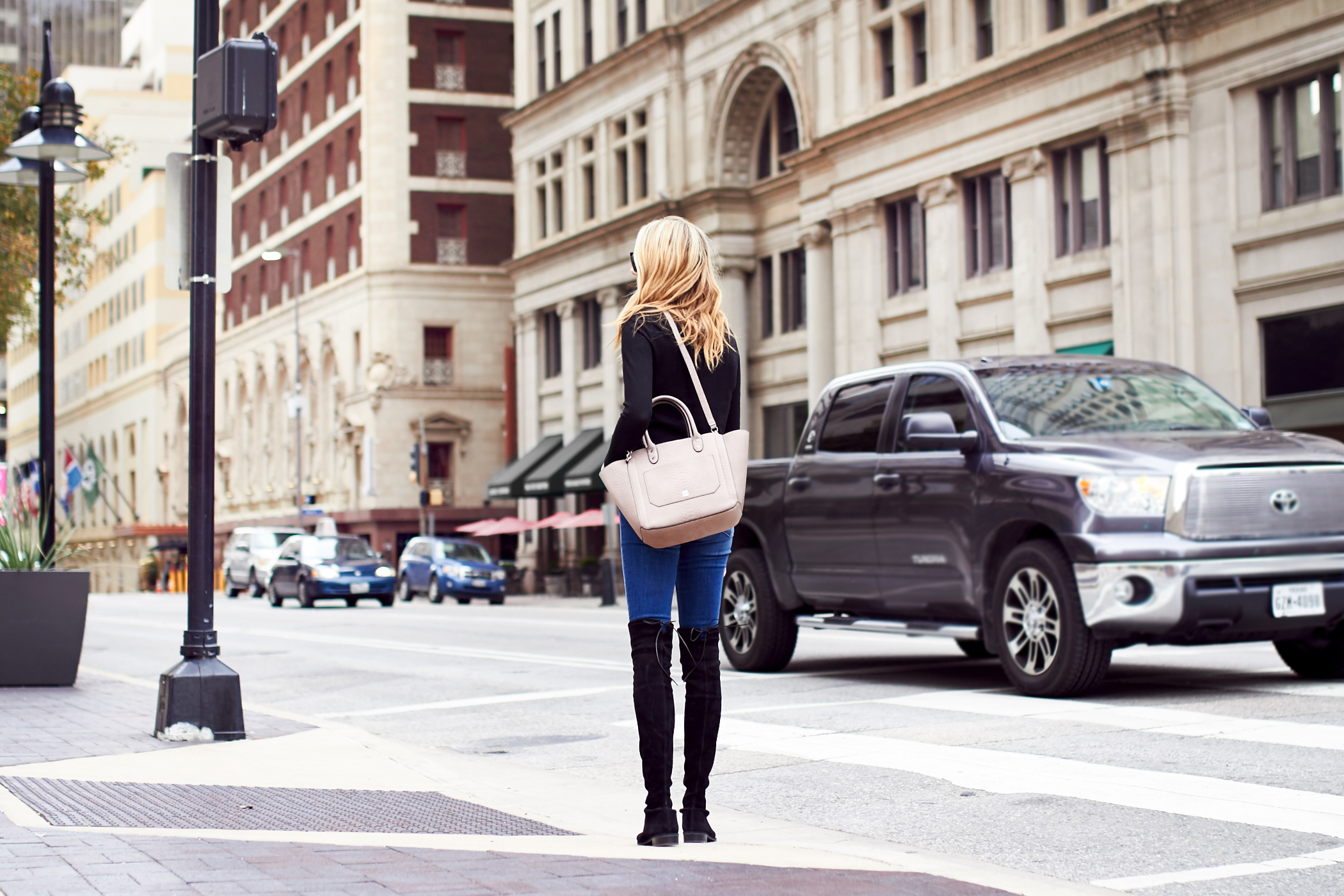 fashion-jackson-ivanka-trump-tribeca-embossed-leather-tote-pale-taupe-black-sweater-denim-skinny-jeans-black-over-the-knee-boots