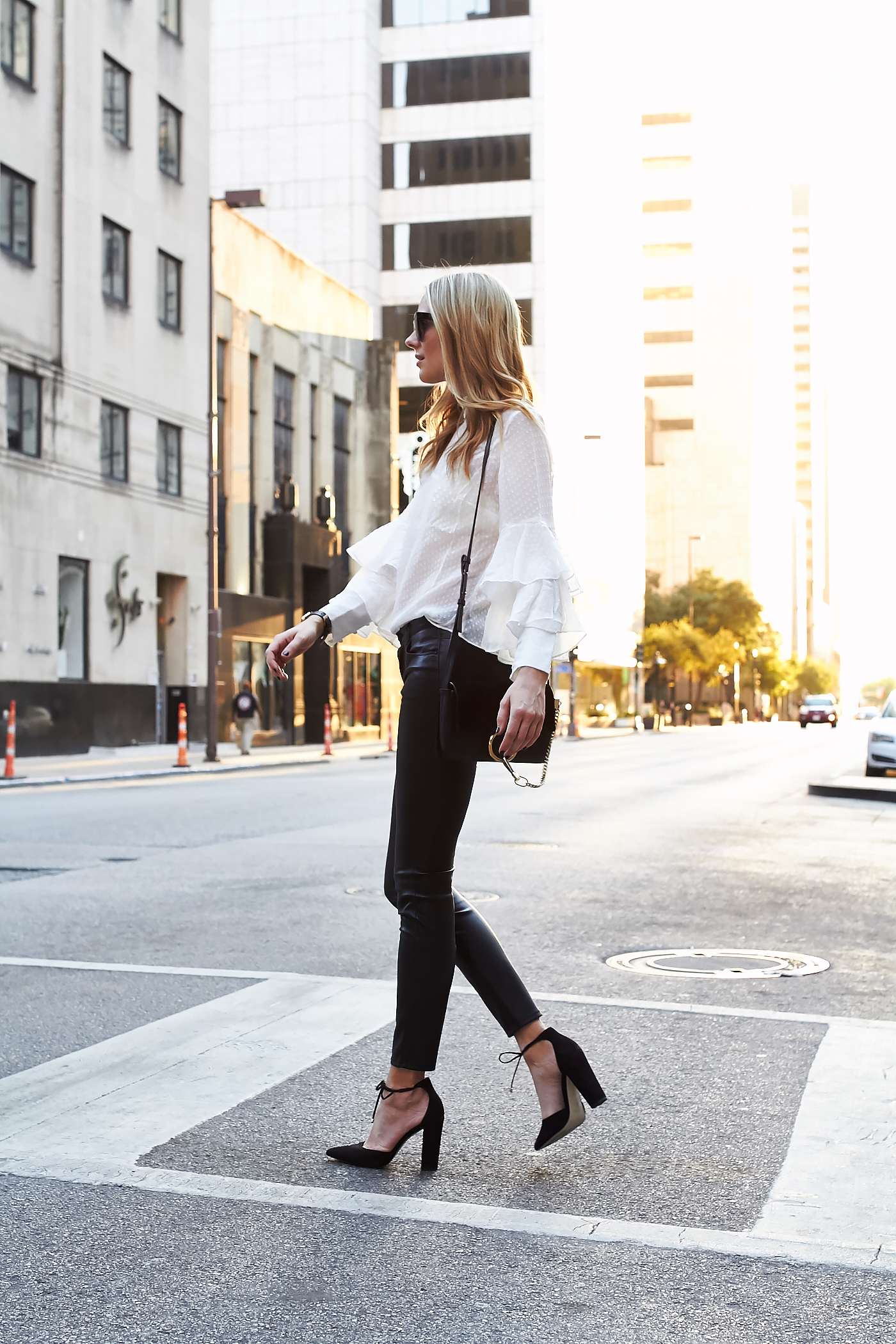 fashion-jackson-white-ruffle-sleeve-blouse-black-faux-leather-pants-black-bow-heels