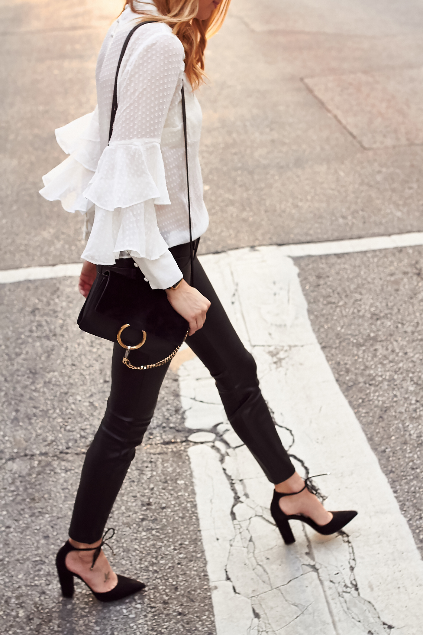 fashion-jackson-white-ruffle-sleeve-top-black-faux-leather-skinny-pants-chloe-faye-handbag-black-bow-pumps