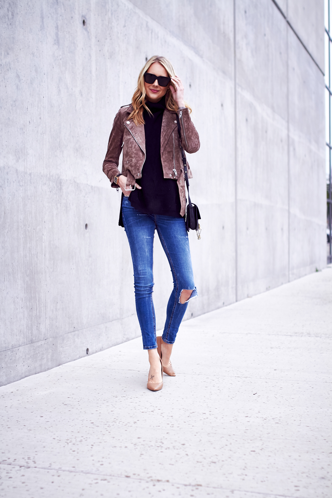 fashion-jackson-black-sunglasses-blanknyc-morning-suede-moto-jacket-black-sweater-ripped-denim-jeans-nude-pumps