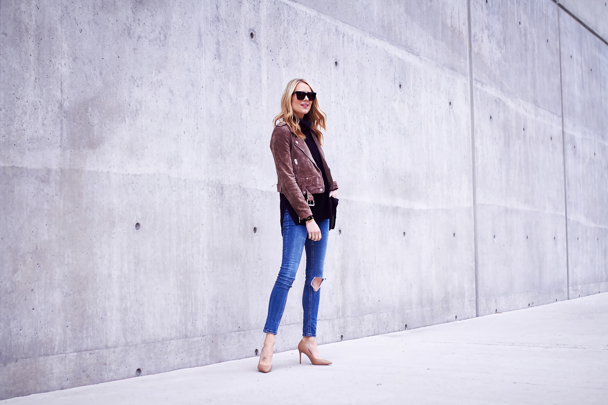 fashion-jackson-blanknyc-morning-suede-moto-jacket-black-sweater-ripped-denim-jeans-black-sunglasses-nude-pumps