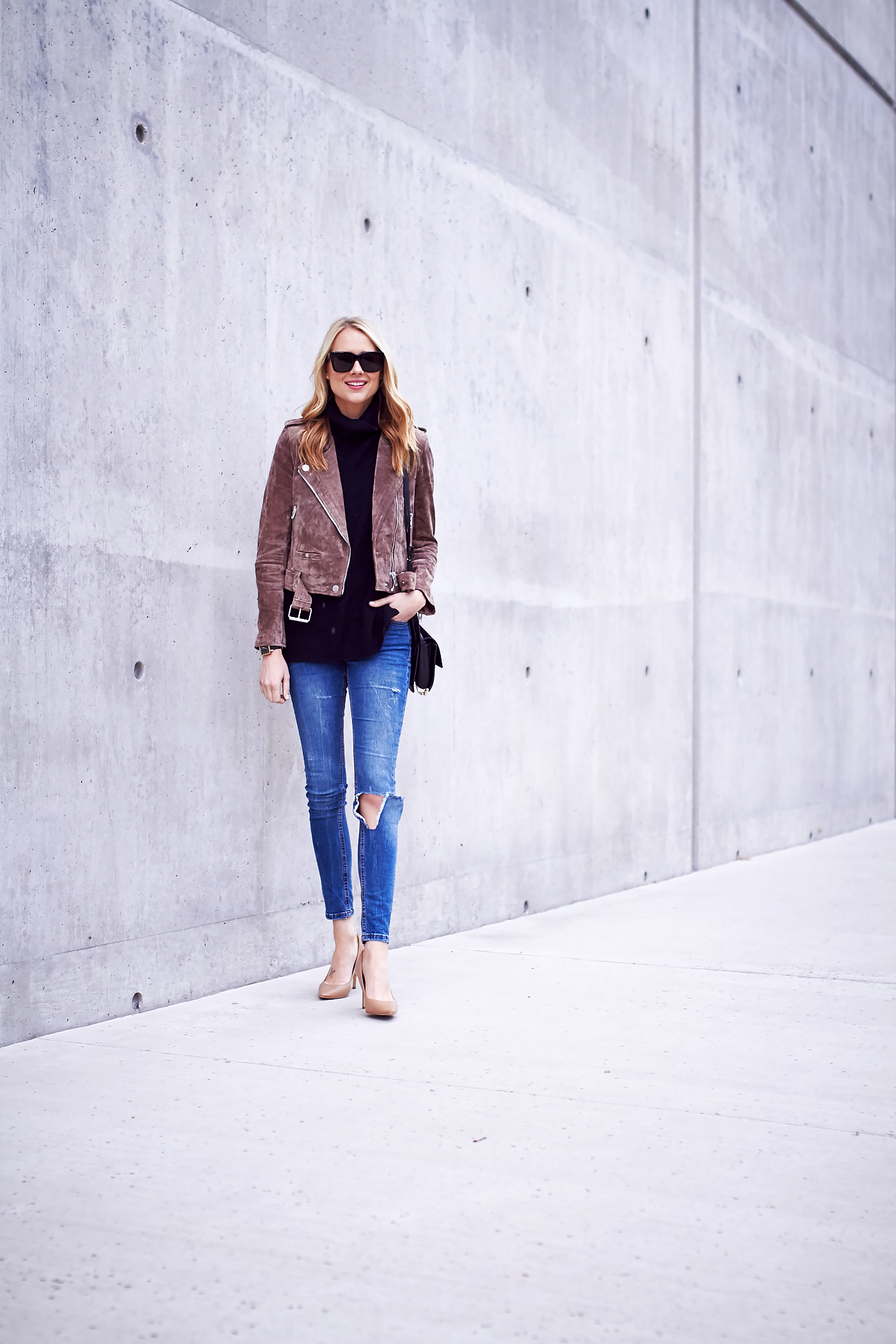 fashion-jackson-blanknyc-morning-suede-moto-jacket-black-sweater-ripped-denim-jeans-nude-pumps-black-sunglasses