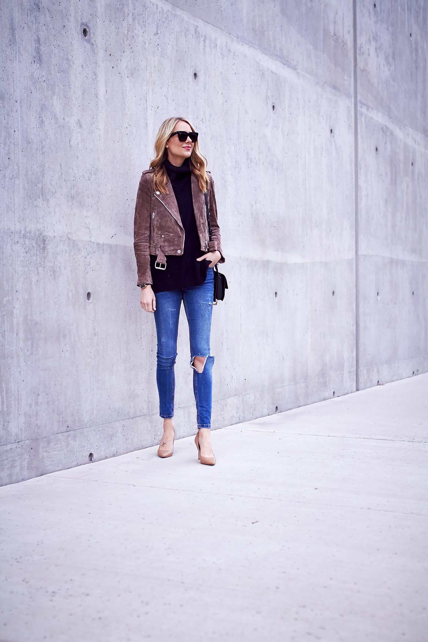 fashion-jackson-blanknyc-morning-suede-moto-jacket-black-sweater-ripped-denim-jeans-nude-pumps