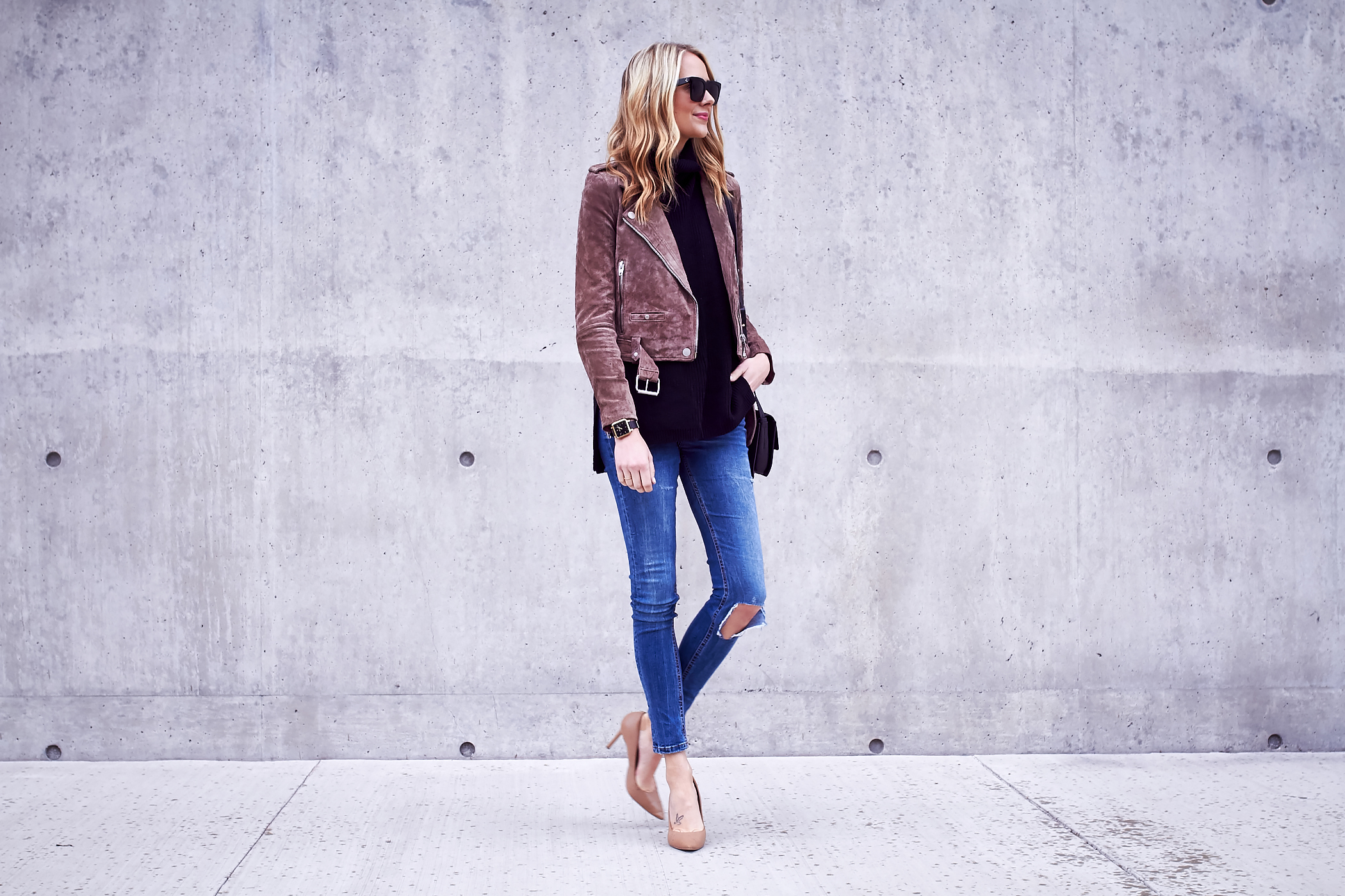 fashion-jackson-blanknyc-morning-suede-moto-jacket-black-turtleneck-sweater-ripped-denim-jeans-nude-pumps-black-sunglasses