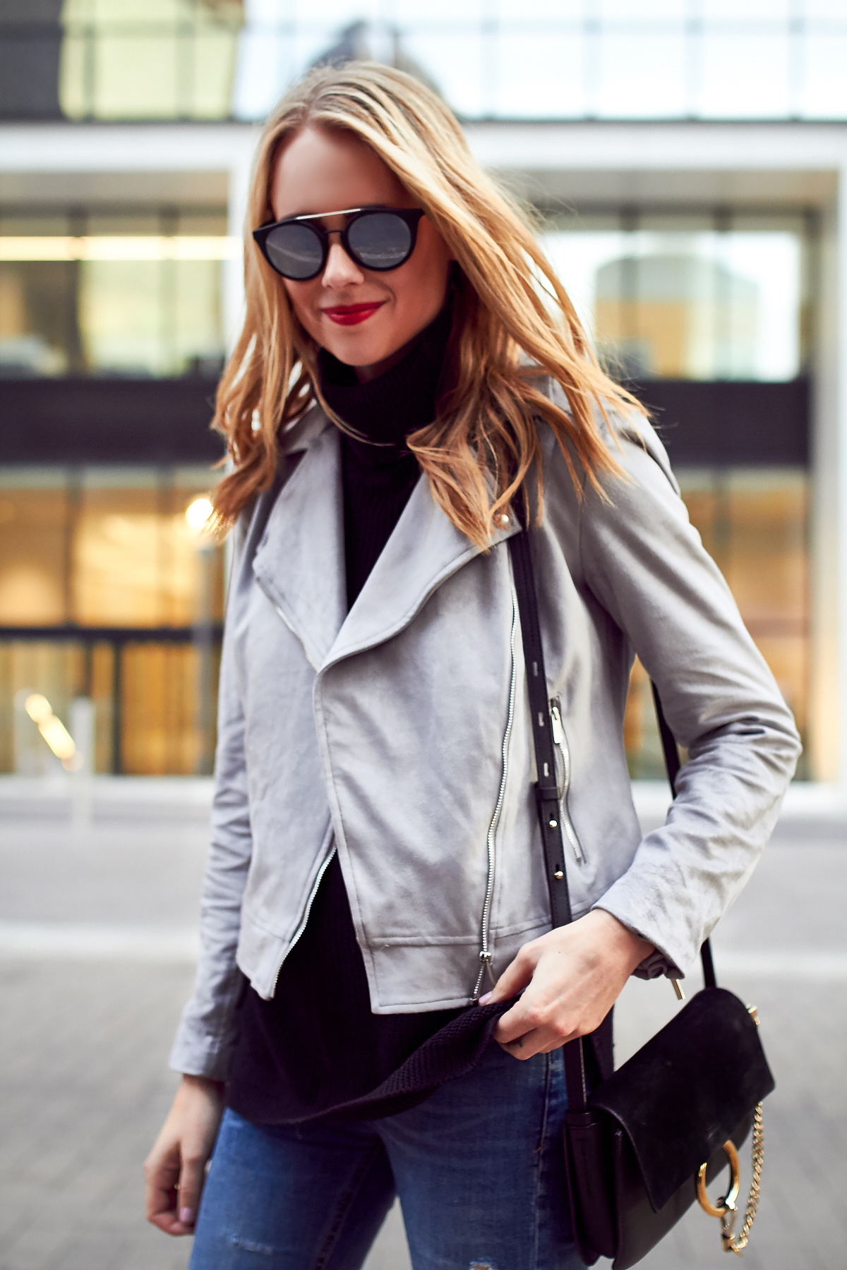 Fall Outfit, Grey Suede Moto Jacket, Black Turtleneck Sweater, Denim Ripped Skinny Jeans, Chloe Faye Handbag
