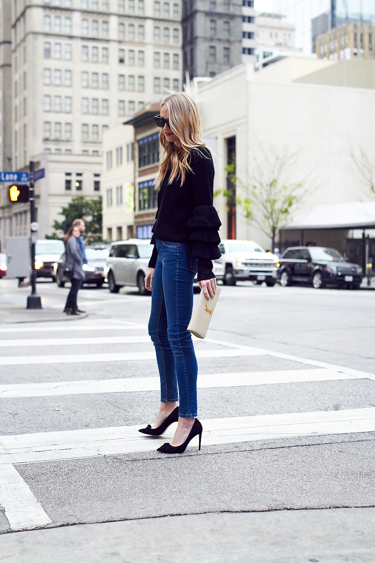 Fall Outfit, Winter Outfit, Ruffle Sleeve Sweater, Denim Skinny Jeans, Black Bow Pumps, Red Lipstick, Saint Laurent Clutch
