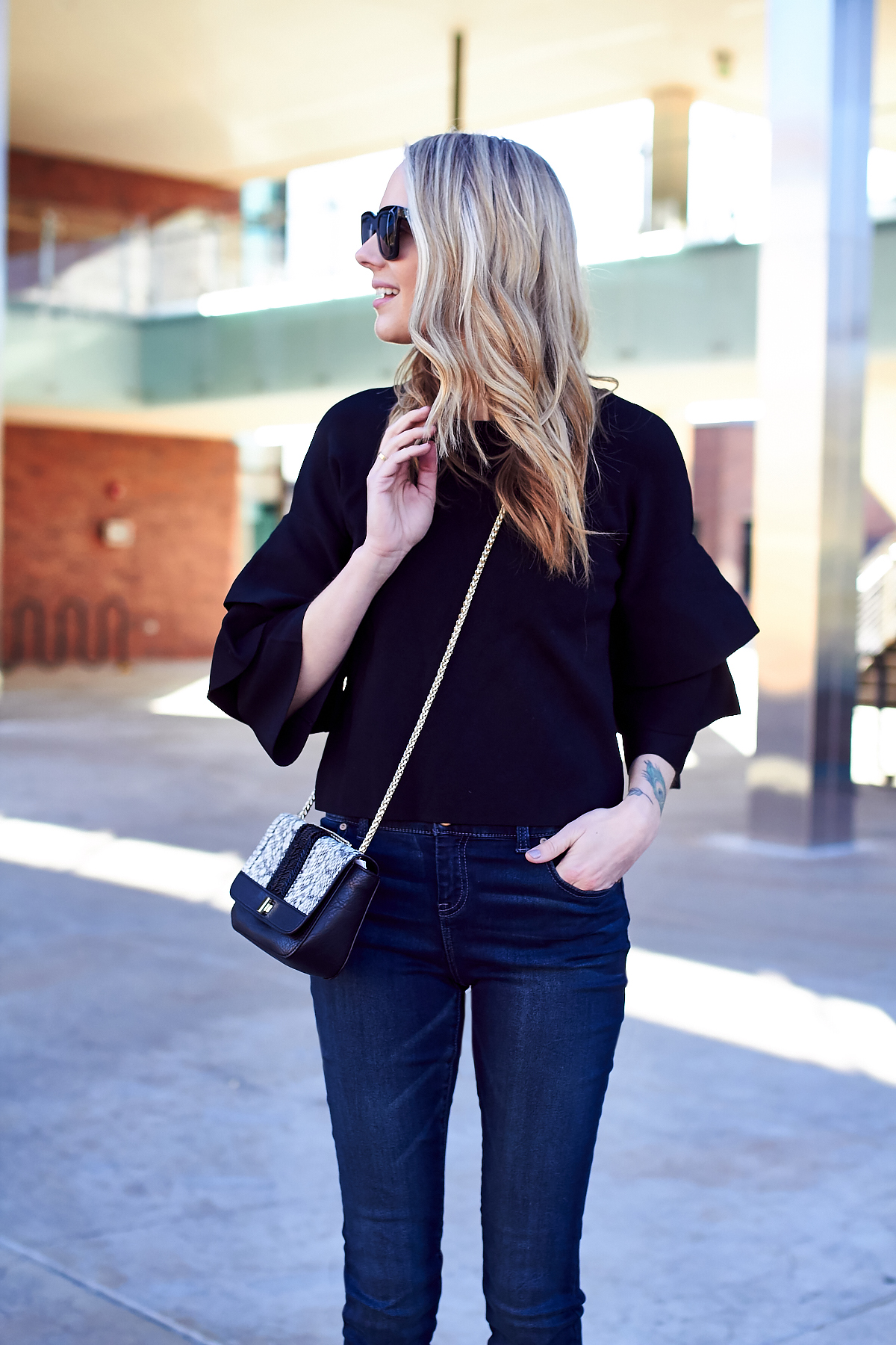 New Year's Eve Outfit, Embellished Handbag, Black Ruffle Sleeve Top, Denim Skinny Jeans