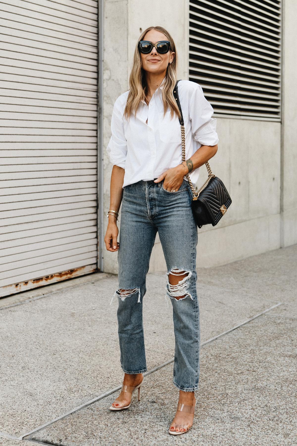 Fashion Jackson Wearing Jenni Kayne White Button Up Shirt AGOLDE Ripped Jeans Chanel Black Boy Bag Schutz Clear Heeled Sandals Street Style